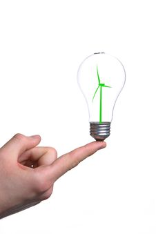 Person Holding A Modern Green Light Bulb Royalty Free Stock Photography