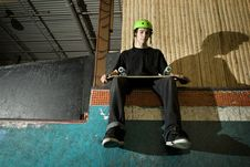 Free Skateboarder Sitting On Ramp Royalty Free Stock Photo - 8337195