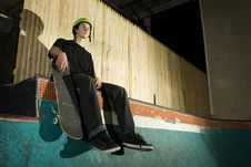 Free Skateboarder Sitting On Ramp Royalty Free Stock Photography - 8337347