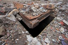 Manhole Covered With Rubble. Stock Image
