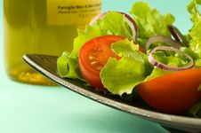 Free Healthy Fresh Salad On Blue Background Royalty Free Stock Photography - 8342327