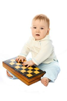 Free Baby With A Chessboard Royalty Free Stock Photography - 8344257