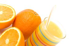 Glass Of Juice And Oranges Stock Photography