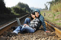 Free A Young Couple Standing On A Railway Royalty Free Stock Photography - 8357827