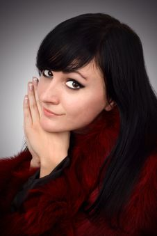 Free Brunette Is In A Red Fur Coat Royalty Free Stock Images - 8350329