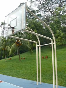 Free Basketball Frame With Trees And Grass Behind Stock Photos - 8351433
