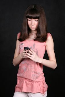 Free Girl With A Phone Royalty Free Stock Image - 8352206