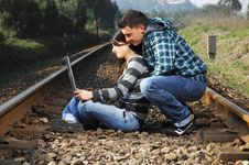 Free A Young Couple Standing On A Railway Royalty Free Stock Images - 8357779