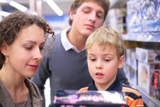 Parents With Son With Toy In Shop Stock Image