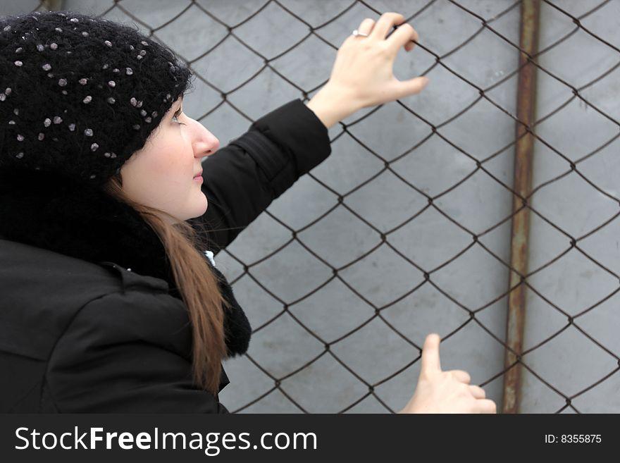 Girl clambers on the net