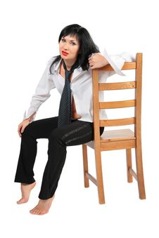 Tired Brunette With Necktie On Chair Stock Photography