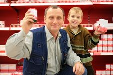 Free Grandfather And Grandson In Food Shop Stock Photography - 8360322