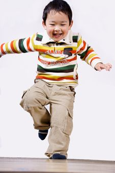 Free Boy Jumping And Laughing Royalty Free Stock Photo - 8361115