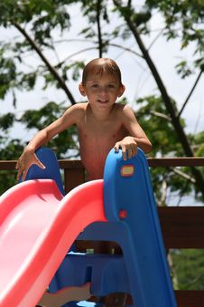 Free Boy On A Water Slide Royalty Free Stock Image - 8364346