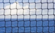 Free Blue Sea Beyond Rope Fence Royalty Free Stock Photos - 8364938