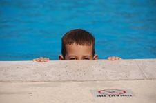 Free Boy Peeking Out Of A Pool Stock Photos - 8365193