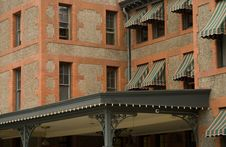 Free Red Brick Building With Awnings Royalty Free Stock Photos - 8369128