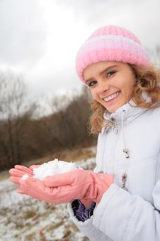 Young Beauty Girl Outdoor In Winter Holds Snow Stock Images