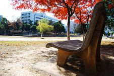 Free The Stone Chair In The Red Maple Leaf Stock Images - 8371964