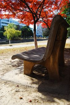 Free The Stone Chair In The Red Maple Leaf Royalty Free Stock Photography - 8372097