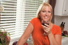 Attractive Blond With A Glass Of Wine Stock Photography