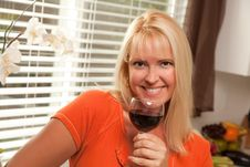 Attractive Blond With A Glass Of Wine Royalty Free Stock Photos