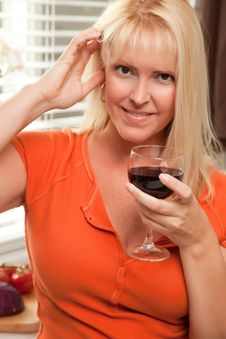 Attractive Blond With A Glass Of Wine Stock Photos