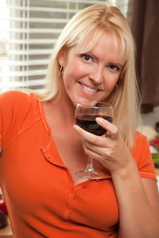 Attractive Blond With A Glass Of Wine Stock Photo