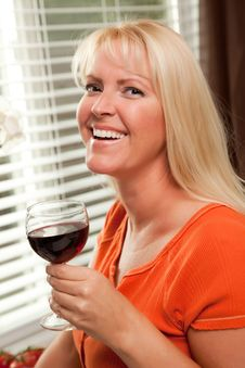 Free Attractive Blond With A Glass Of Wine Stock Image - 8372711