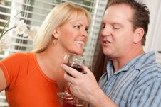 Happy Couple Enjoying Wine Stock Photos