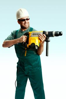 Free Smiled Workman Drilling With Perforator Stock Photos - 8373623