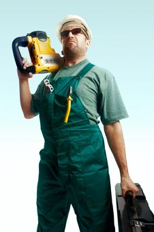 Skeptic Workman With Perforator On The Shoulder Royalty Free Stock Photo