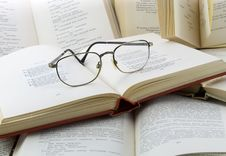 Many Books And Glasses Stock Image