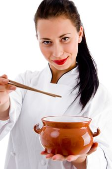 Woman Chef With Chopsticks And Porcelain Pot Royalty Free Stock Photos
