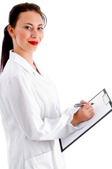 Doctor Busy With Her Clipboard Stock Photography