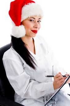 Free Smart Doctor In Christmas Hat Writing Prescription Stock Photo - 8375820