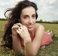 Free Woman Laying On The Grass Royalty Free Stock Photos - 8387018