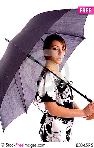 Side Pose Of Young Woman Holding An Umbrella Free Stock