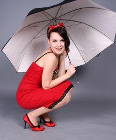 Pin-up Girl Sitting Under Umbrella Royalty Free Stock Photos