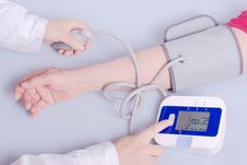 Checking Blood Pressure Royalty Free Stock Photos
