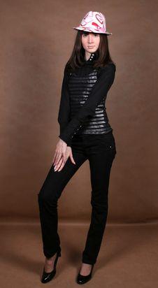 Pretty Girl Standing In Studio Stock Photo