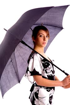 Free Side Pose Of Young Woman Holding An Umbrella Royalty Free Stock Photo - 8384595