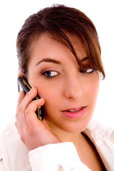 Side Pose Of Woman Busy On Mobile Looking Sideways Stock Photography