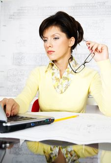 Free Caucasian Engineer With Blueprints Is Pensive Royalty Free Stock Photography - 8385407