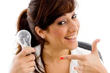 Free Portrait Of Smiling Woman Indicating Bulb Royalty Free Stock Photos - 8386138