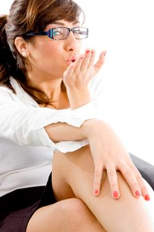 Side Pose Of Woman Giving Flying Kiss Stock Photo