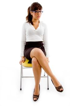 Free Front View Of Woman Sitting On Chair Royalty Free Stock Photo - 8386425