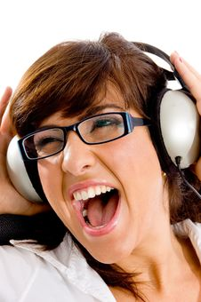 Free Close View Of Shouting Woman Listening Music Royalty Free Stock Image - 8386426