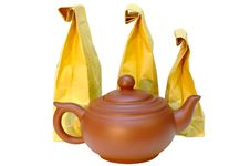 Pottery (clay) Teapot And Tea In Paper Bags. Royalty Free Stock Photos