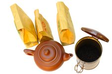 Pottery (clay) Teapot, Tea In Paper Bags And Tin. Stock Image